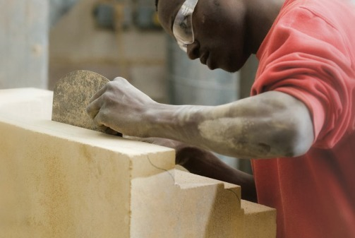 A young stonemason practicing his craft