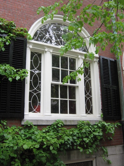Window in Boston with shutters designed to cover the window