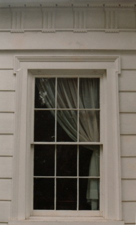 Greek Revival window in Indiana with thin muntins and large panes of glass