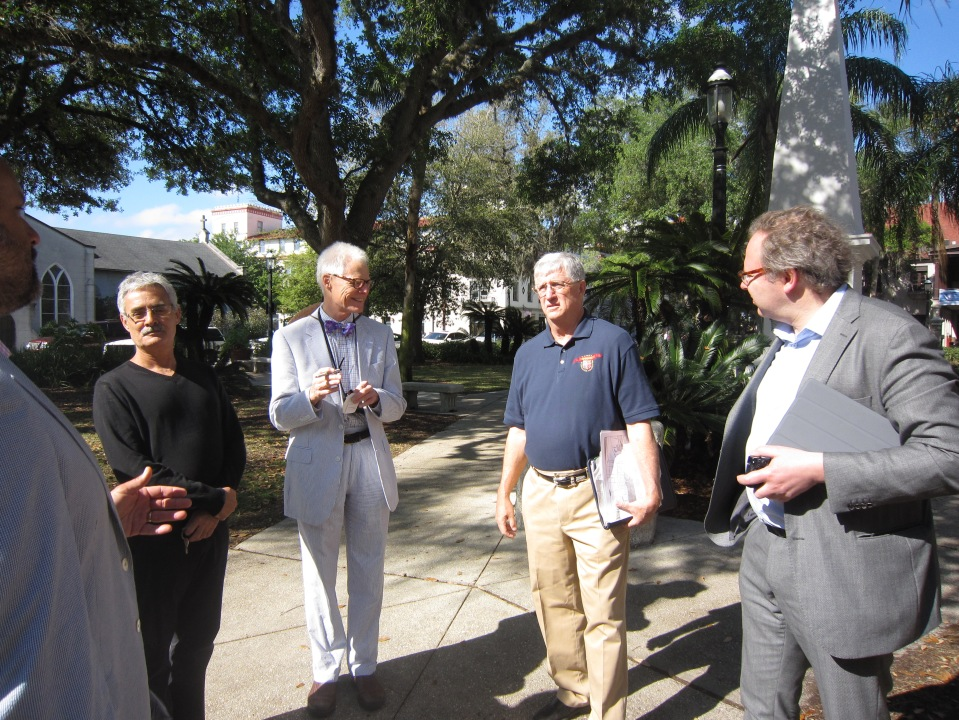 Rafaello Fornese, Thomas Gordon Smith and Semyon Mikhailovsky listen to an introduction to St. Augustine by Paul Weaver of the Florida Trust for Historic Preservation (center right).